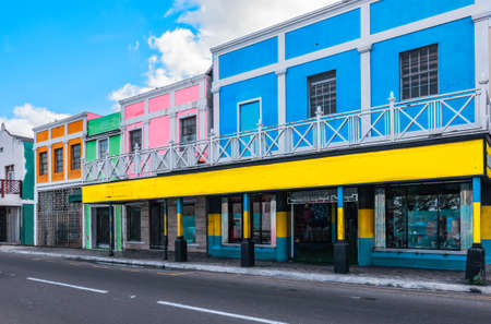 Colorful buildings in a shopping street in the capital city of Nassau, The Bahamas.