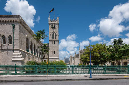 BRIDGETOWN, BARBADOS - MARCH 23, 2019: Parliament building with clock tower and national flag in Bridgetown, Barbados, Caribbean.