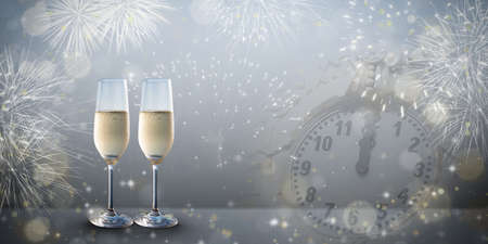 New Years eve concept with two glasses of bubbly champagne on a silver grey colored design background. Фото со стока