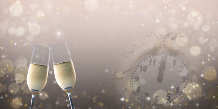 Celebration toast with champagne and blurred clock. New Year's background.