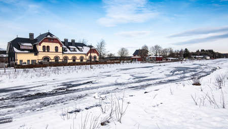 Snowy landscape with old train station in Sourbrodt, Waimes, Ardennes, Belgium. Фото со стока