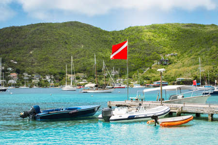 Boats in the harbor of Bequia, St Vincent and the Grenadines. Фото со стока