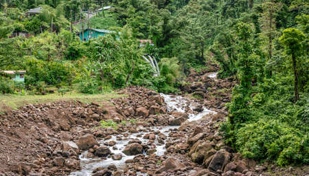 Stream through a rocky river in nature of Dominica.