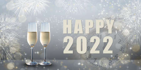New Year celebration: Glasses of champagne and Happy 2022 text. Фото со стока