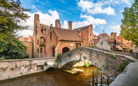 Old famous canal bridge in Bruges Belgium.