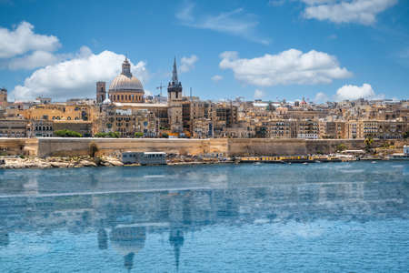 Valletta, Malta city skyline with reflection in water. Фото со стока