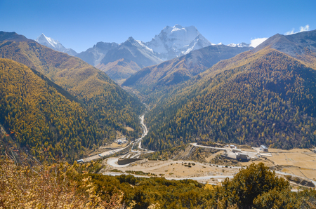 Lanscapes of snow mountain with crest curve of road to Yading nature reserve, The last Shangri la, Daocheng-Yading, Sichuan, China.