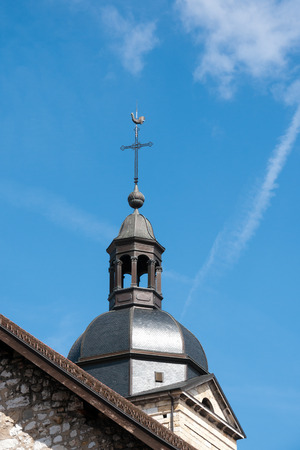 steeples: Church Steeple with Cross in small Town of France Editorial