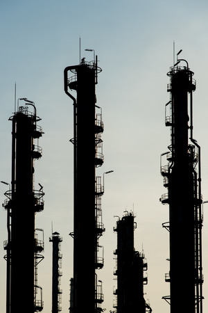 petrochemicals: The dusk sky behinds Natural Gas Plant leaving silhouette look on the tower.