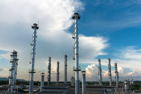 natural process: Process Columns of Natural Gas Plant with blue sky and cloud background Stock Photo