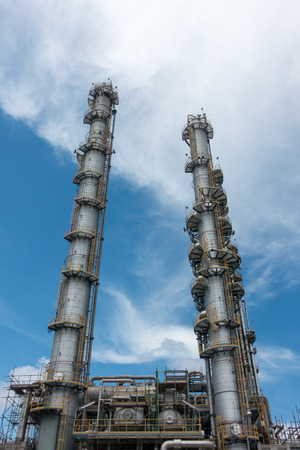 natural process: Process Columns of Natural Gas Plant with blue sky background Stock Photo