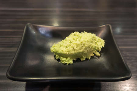 wasabi: Portion of Wasabi on black ceramic plate Stock Photo