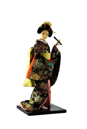 Japanese geisha doll isolated on white photo