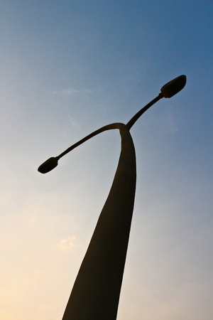 Streetlight isolated on blue sky photo