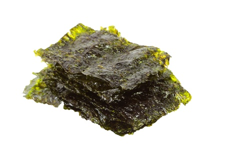 Isolated dark green sheets of a salted nori sea weed on the whit background