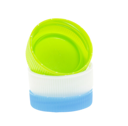 Plastic bottle caps isolated against a white background photo