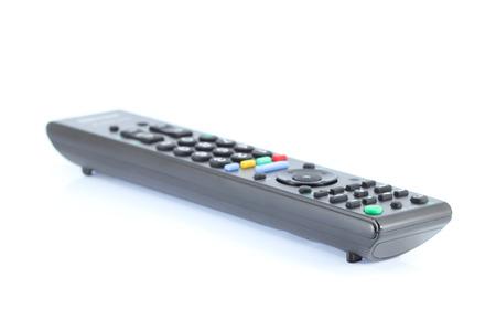 tv remote control keypad black on white isolated photo