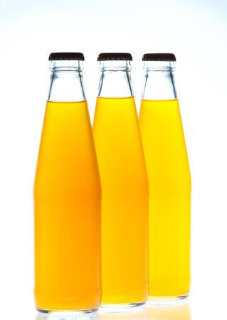 Orange juice glass bottle. Isolated on white background photo