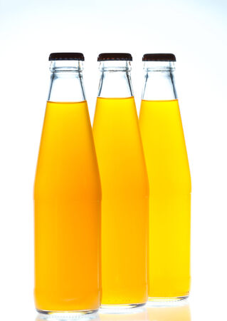 Orange juice glass bottle. Isolated on white background photo