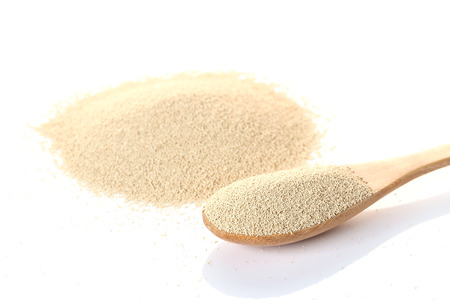 Dry Yeast isolated on white Standard-Bild