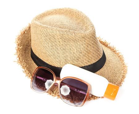 sun hat: Sunglasses, hat and sunblock. Stock Photo