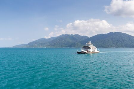 TRAT, THAILAND  April 2 : Cars loaded on ferry boat and heading to Koh Chang island on April 2, 2015 in Koh Chang, Trat, Thailand.