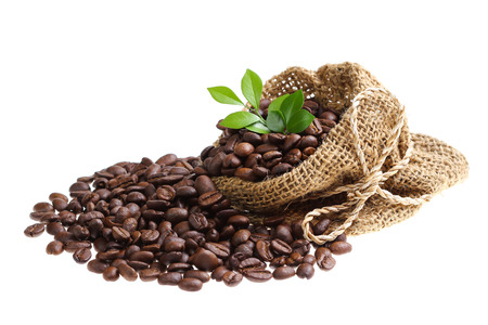 Coffee beans in canvas sack isolated on white background photo
