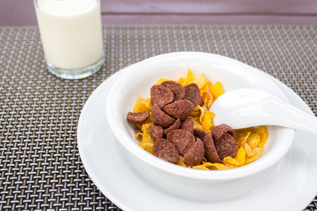 milk pouring: Breakfast with milk pouring in corn flakes Stock Photo
