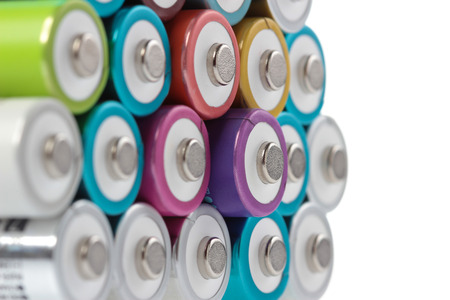 aa: Several AA batteries in perspective closeup view on white background