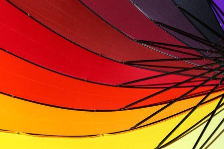 Colorful umbrella for a colorful background. Standard-Bild