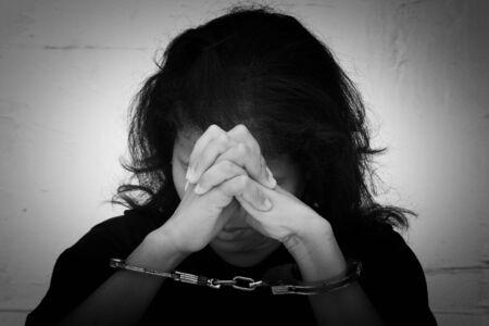handcuff: women hand in handcuff Stock Photo