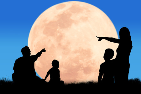 silhouette father and mother hand point his son looking forward at the full moon night background