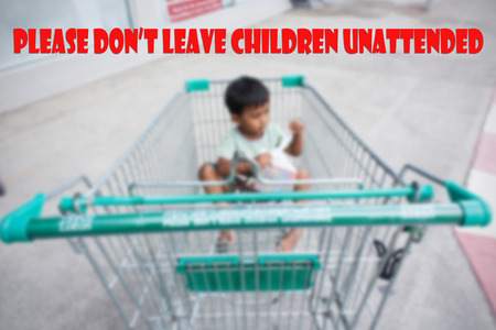 unattended: concept please dont leave children unattended in cart Stock Photo