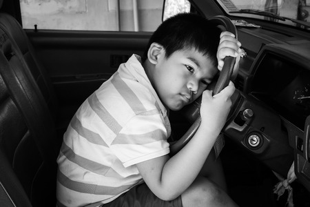 insular: the boy sad alone in the old car,vintage tone Stock Photo
