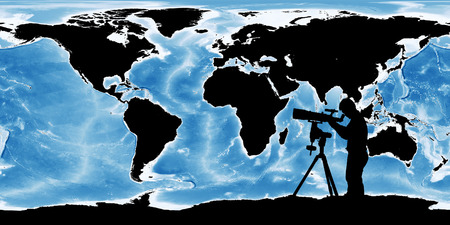 eyepiece: silhouette of young man looking through a telescope at to the earth, the backdrop of the planet earth.  Stock Photo
