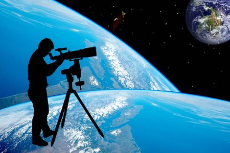 eyepiece: silhouette of young man looking through a telescope at to the earth, the backdrop of the planet earth. Elements of this image furnished by NASA.
