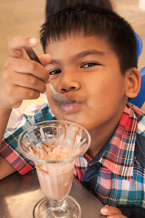 jimmies: asian little boy  dripping ice cream Stock Photo