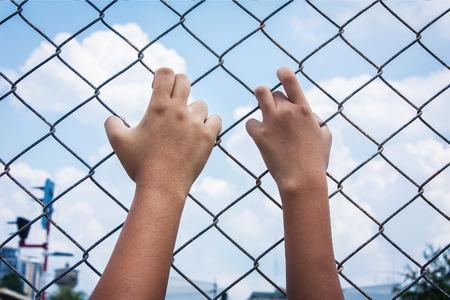 jail: asian girl hand hold jail