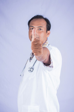 assent: doctors hand show assent on white background Stock Photo
