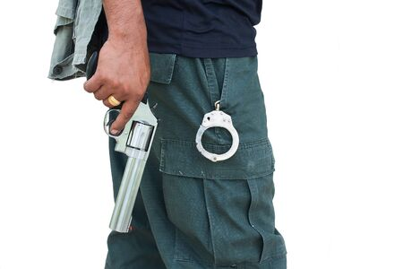 man standing and hand holding gun revolver ,side view Stock Photo