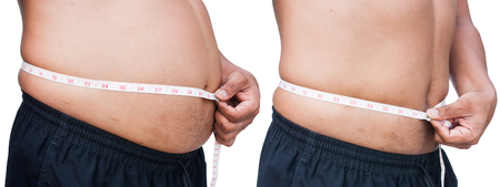 fat belly: Man measuring belly fat itself, between before and after Stock Photo