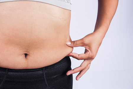 Women body fat belly front view Stock Photo