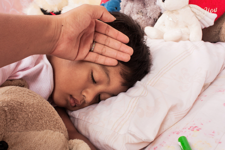 unwell: a little asian boy sick