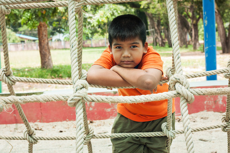 caucasian children: portrait of  asian cute  boy at playground