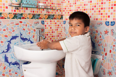 little boy washing hand in the bathroom Stockfoto