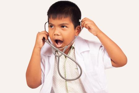 stethoscope boy: little boy play stethoscope isolate background