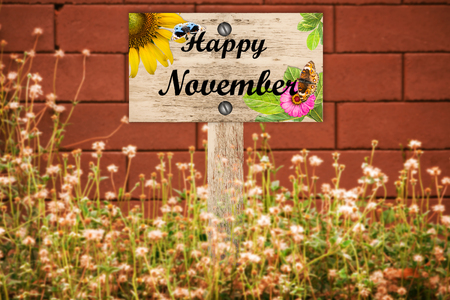 beautiful woodland: happy November signpost in beautiful woodland with vintage floral meadow filter