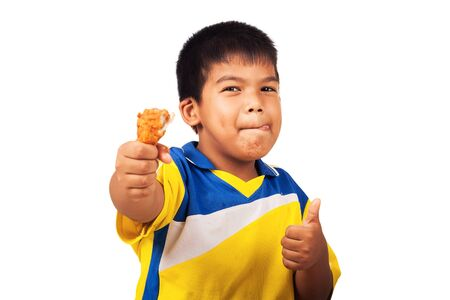 assent: little boy eating fried chicken isolate background