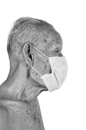 80 year old: elderty man wearing mask,black and white tone