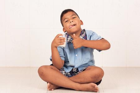 concede: school  boy drinking milk and concede